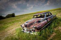 An Old Cadillac in the field