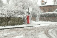 Village post box snow scene