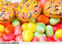sweet-cakes-and-colourful-gums-at-the-background-c