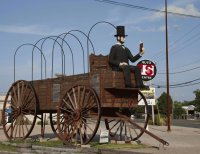 Abe Lincoln sits on a wagon on route 66  Illinois