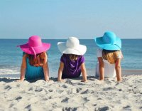 Girls in Floppy Easter Hats at the Beach