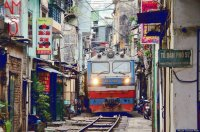 Railroad in a busy street  Hanoi  Vietnam