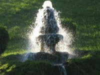 Water fountain in setting sun