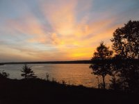 Sunrays at dusk over Miramichi River