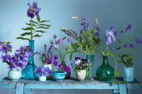 Flowers in Antique Glass Containers