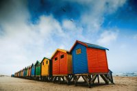Colorful surfer shacks at Muizenberg Beach, Cape T